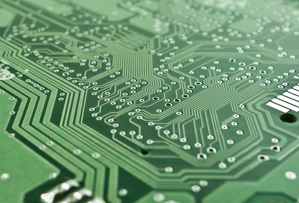 Close up photo of a green printed circuit board