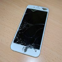 Smashed white smartphone screen